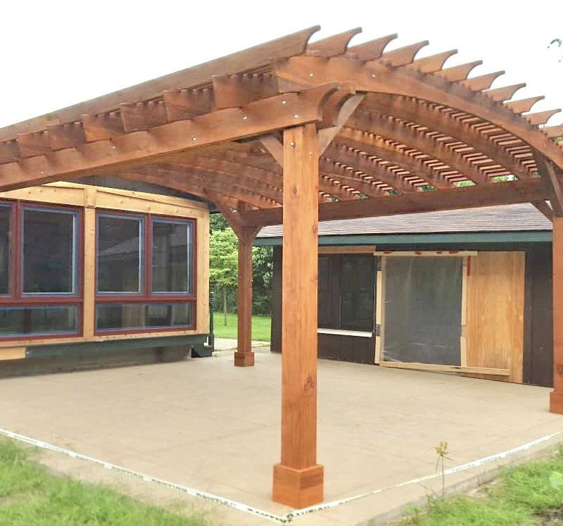 Sebastopol Pergolas (Options: 21' L x 19' Arc W, Mature Redwood, 4-Post Anchor Kit for Gale-Wind, with a Ceiling Fan Base, Transparent Premium Sealant). Photo Courtesy of R. Erickson of Sawyer, Michigan.
