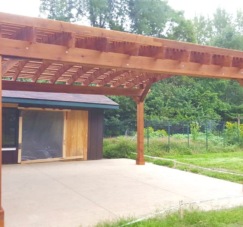 Sebastopol Pergola (Options: 21' L x 19' Arc W, Mature Redwood, 4-Post Anchor Kit for Gale-Wind, with a Ceiling Fan Base, Transparent Premium Sealant). Photo Courtesy of R. Erickson of Sawyer, Michigan.
