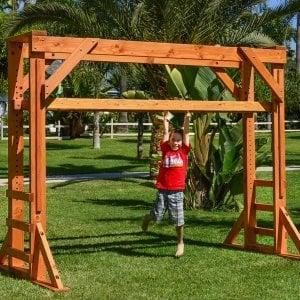 Sheldon's Monkey Bar (Options: 7ft H, 9ft L, Douglas-fir, 3/4-inch Diameter Rungs Spaced 6 inches Apart, Standard Step Option, Transparent Premium Sealant). Only 3 ladder steps by custom request. Height of the monkey bars is adjustable to fit kits of all ages!