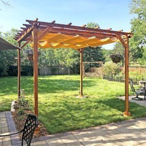 Small Pergola (Options: 12' x 12', Garden Type, Standard Timbers, Redwood, Open Roof, 9.5 ft Post Height, 4-Post Anchor Kit for Gale-Wind, No Ceiling Fan Base, No Louver Privacy Panels, No Curtain Rods, Transparent Premium Sealant).  Canopy purchased from Infinity Canopy. Photo Courtesy of J. Minniti of Lisle, Illinois.