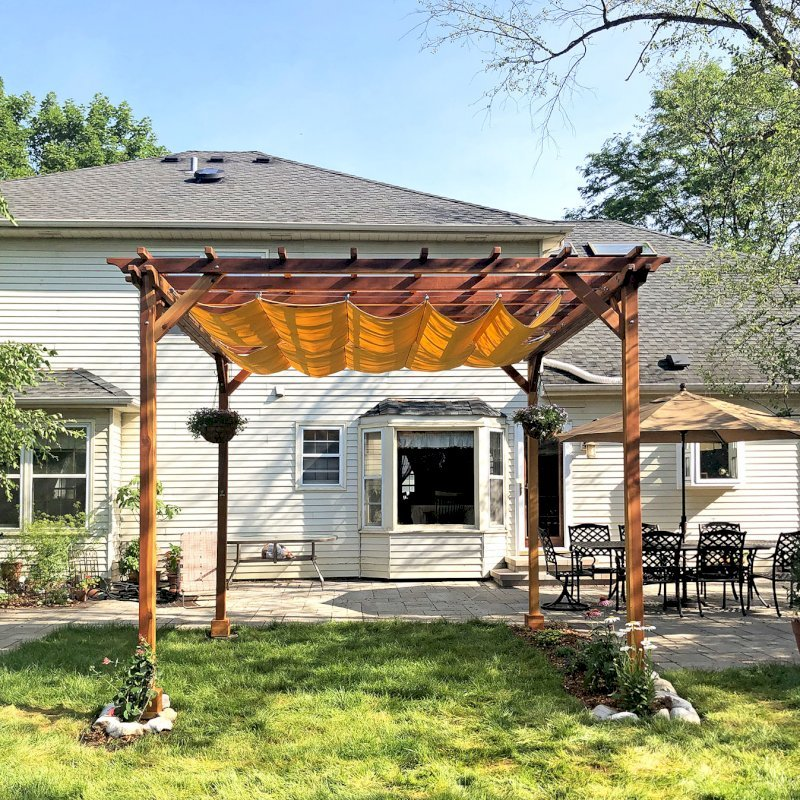 Small Pergola (Options: 12' x 12', Garden Type, Standard Timbers, California Redwood, Open Roof, 9.5 ft Post Height, 4-Post Anchor Kit for Gale-Wind, No Ceiling Fan Base, No Louver Privacy Panels, No Curtain Rods, Transparent Premium Sealant).  Canopy purchased from Infinity Canopy. Photo Courtesy of J. Minniti of Lisle, Illinois.