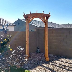 """Small Pergola (Options: 5' x 5', Arched Type, 2x6's Supports and Rafters by Custom Request, California Redwood, Open Roof with Slats at 18"""", Rafters at 18"""", 8.5 ft Post Height, Transparent Premium Sealant). Photo Courtesy of M. Hall of Peoria, Arizona."""