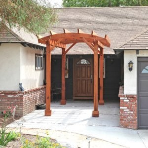 "Small Pergola (Options: 8' x 15', Arched Type, Standard-Thickness Timbers, Mature Redwood, Open Roof with Slats at 18"", Rafters at 18"", Lengthwise Roof Support Timbers, 9 ft Post Height, Transparent Premium Sealant). Photo Courtesy of B. McCusker of Glendora, CA."