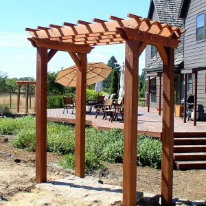 "Small Pergola (Options: 8' x 6', Garden Type, Extra Thick Timbers, Mature Redwood, Open Roof with Slats at 12"", Rafters at 18"", Widthwise Roof Support Timbers, 9 ft Post Height, 4-Post Anchor Kit for Stone, No Ceiling Fan Base, No Privacy Panels, No Curtain Rods, Transparent Premium Sealant)."