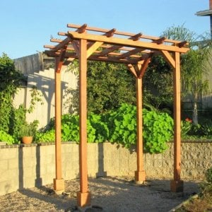"Small Pergola (Options: 8' x 8', Garden Type, Standard Timbers, Mature Redwood, Open Roof with Slats at 18"", Rafters at 18"", 9 ft Post Height, 4-Post Anchor Kit for Stone, No Ceiling Fan Base, No Privacy Panels, No Curtain Rods, Transparent Premium Sealant). Photo Courtesy of Aileen & Francis Knowles of San Diego, CA."