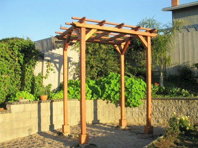 """Small Pergola (Options: 8' x 8', Garden Type, Standard Timbers, Mature Redwood, Open Roof with Slats at 18"""", Rafters at 18"""", 9 ft Post Height, 4-Post Anchor Kit for Stone, No Ceiling Fan Base, No Privacy Panels, No Curtain Rods, Transparent Premium Sealant). Photo Courtesy of Aileen & Francis Knowles of San Diego, CA."""
