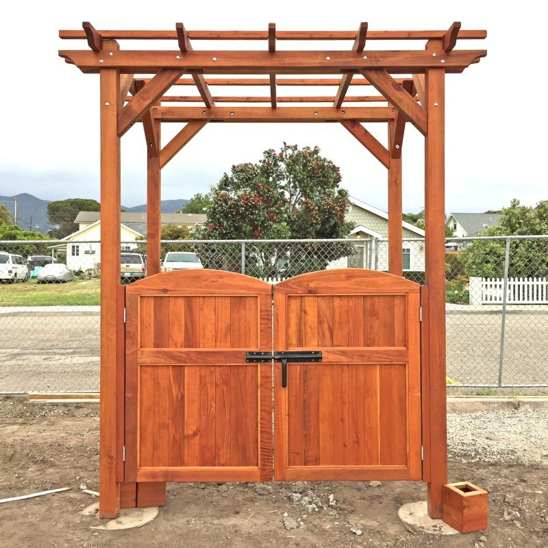 Small Pergola (Options: 8' x 6', Garden Type, Standard Timbers, Mature Redwood, Open Roof, 9 ft Post Height, Anchor Kit for Concrete, No Ceiling Fan Base, With a Pair of Custom Gates by Custom Request, No Curtain Rods, Transparent Premium Sealant). Photo Courtesy of M. Roberts of Carpinteria, CA.