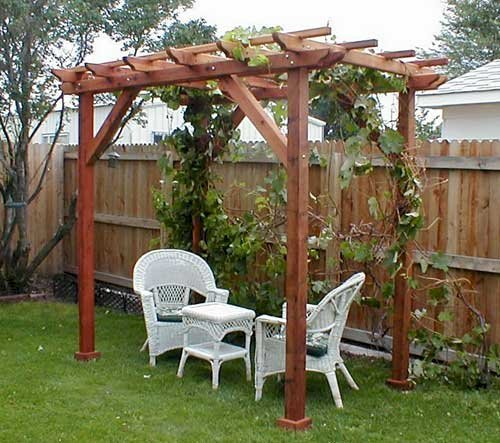 """Small Pergola (Options: 10' x 6', Garden Type, Standard Timbers, Mature Redwood, Open Roof with Slats at 18"""", Rafters at 18"""", Widthwise Roof Support Timbers, 9 ft Post Height, 4-Post Anchor Kit for Stone, No Ceiling Fan Base, No Privacy Panels, No Curtain Rods, Transparent Premium Sealant)."""