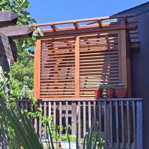 Small Pergola (Options: 8' x 5', Garden Type, Standard Timbers, Old-Growth Redwood, Open Roof, 8 ft Post Height, No Anchor Kit, No Ceiling Fan Base, 1 Louver Privacy Panels, No Curtain Rods, Custom End Cuts, Transparent Premium Sealant). Photo Courtesy of J. Siino of Kirkland, WA.