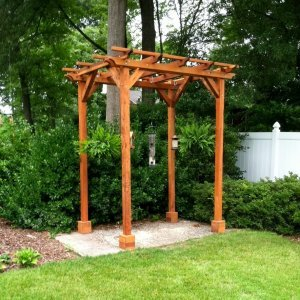"Small Pergola (Options: 8' x 6', Garden Type, Standard-Thickness Timbers, Redwood, Open Roof with Slats at 18"", Rafters at 18"", Lengthwise Roof Support Timbers, 9 ft Post Height, 4-Post Anchor Kit for Stone, No Ceiling Fan Base, No Privacy Panels, No Curtain Rods, Transparent Premium Sealant). Photo Courtesy of James C. of Alexandria VA."