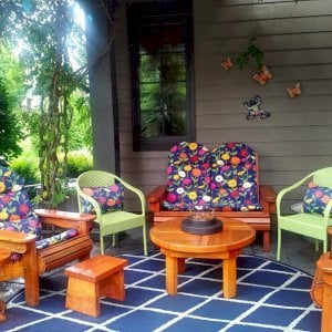 """Small Foot Stool (Options: California Redwood, 12"""" H, No Engraving, Transparent Premium Sealant). Photo also shows Round Terrace Table, 2 Adirondack Folding Chairs, an Adirondack Wooden Loveseat and a Mini 12 inch Round Wood Side Table. Photo Courtesy of Deborah O'Toole of Midlothian, Virginia."""