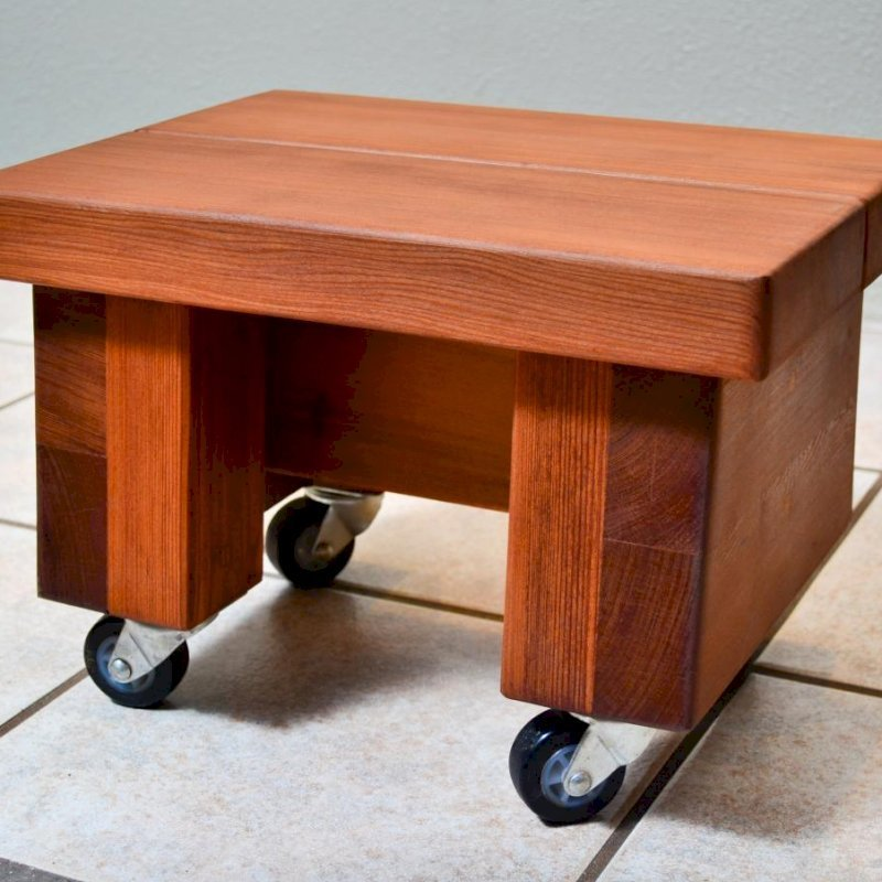 """Small Foot Stool (Options: Mature Redwood, 12""""H, No Engraving, Transparent Premium Sealant). Photo shows custom casters. If you'd like a set of casters added, let us know ($30)."""