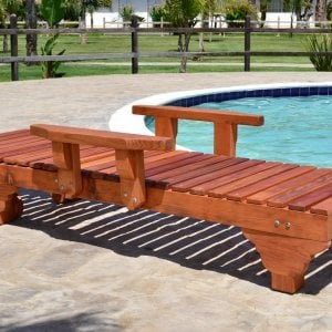 "Sol Lounger (Options: Single, Extra Large 78"", Mature Redwood, Add Armrests, 13""H, Include Wooden Wheels, Transparent Premium Sealant). Photo also shows: The Poolside Privacy Panel"