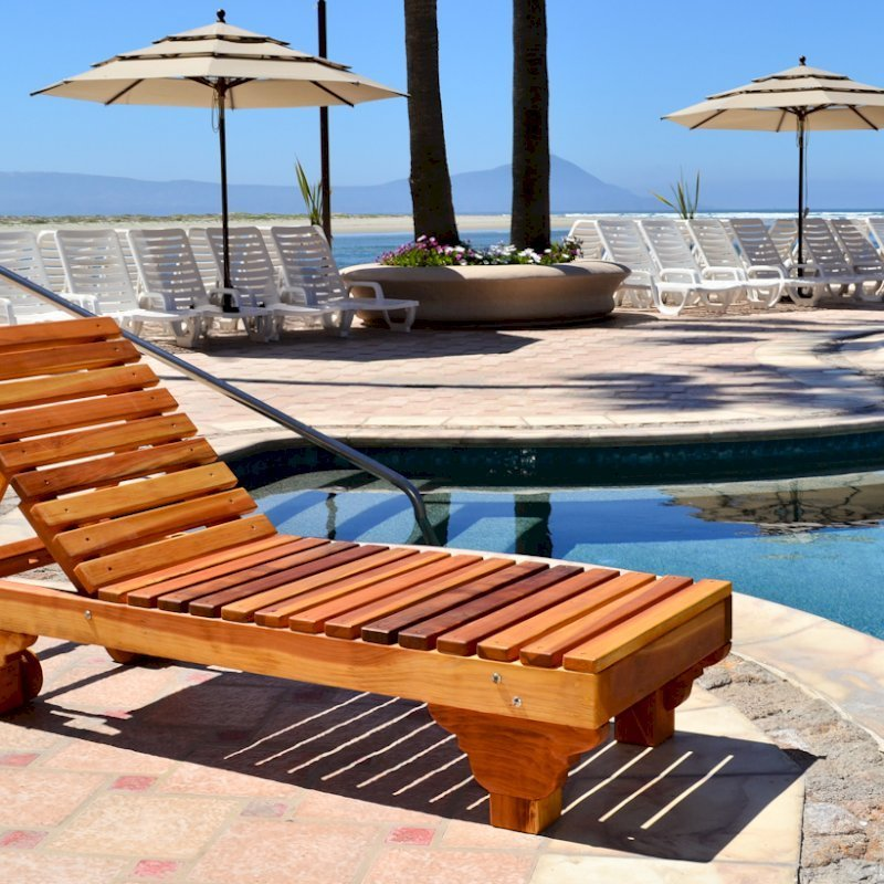 "Sol Lounger (Options: Single, Standard 74"", Redwood, No Armrests, 13''H, Include Wooden Wheels, No Cushion, Transparent Premium Sealant)."