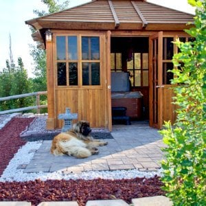 "Spa Gazebo (Options: 12' L, 10' W, Redwood, All Sliding Windows with Screens, 4' x 4' Skylight, 36"" H Siding Below Windows, Vertical Siding, French Doors without Screens, No Flooring, Transparent Premium Sealant). Photo Courtesy of B. Whiteaker of Corvallis, Montana."