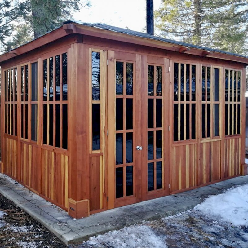 "Spa Gazebo (Options: 14' L, 10' W, California Redwood, A Combination of Fixed and Sliding Windows, Without Skylight, 36"" H Siding Below Windows, Vertical Siding, French Doors without Screens, No Flooring, Transparent Premium Sealant). Photo Courtesy of D. Wolfe of Chester, California."