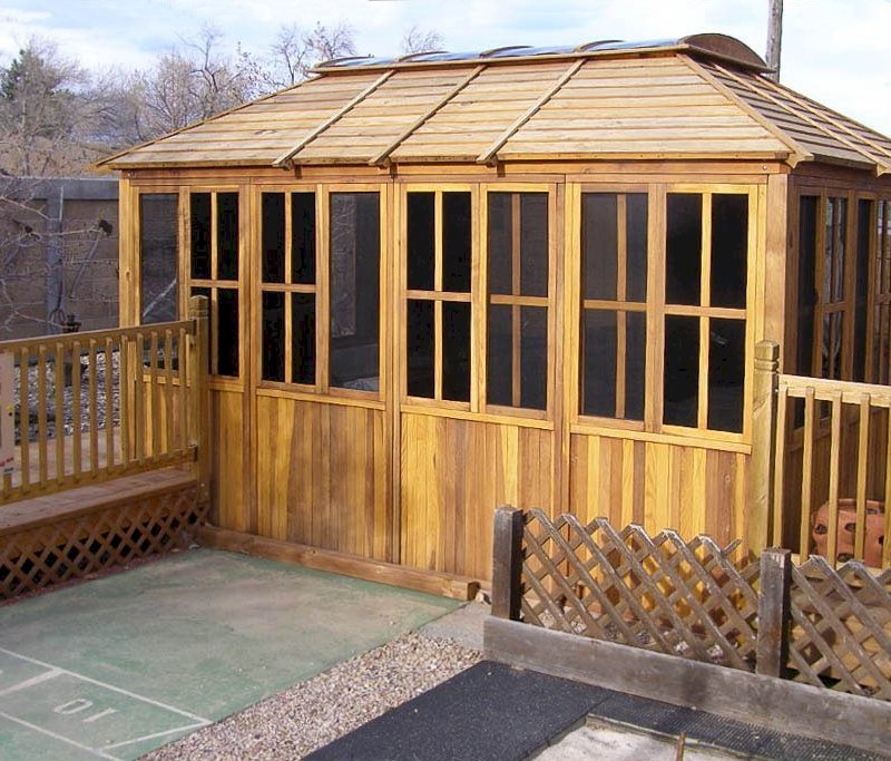 "Spa Gazebo (Options: 10' L, 14' W, Redwood, All Sliding Windows with Screens, 4' x 6' Skylight, 36"" H Siding Below Windows, Vertical Siding, Japanese Doors with Screens, No Flooring, Transparent Premium Sealant). Photo Courtesy of Richard S. of Loveland, Colorado."