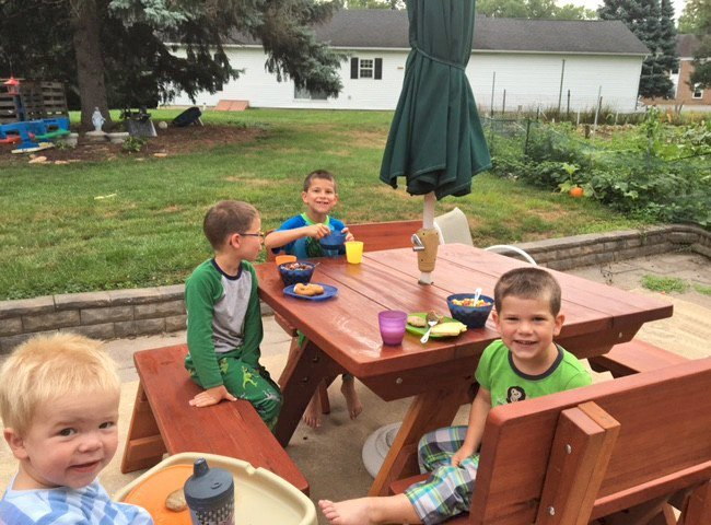 """Heritage Picnic Table (Options: 46"""" x 46"""" Tabletop, Side Benches and Fullback End Benches, Standard Tabletop, Rounded Corners, 2"""" Umbrella Hole, Transparent Premium Sealant). Photo Courtesy of M. Kellett of York, PA."""