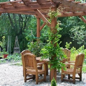 Square Patio Table Under a Garden Pergola (Options: 4.5', 4 Chairs, Mature Redwood, Luna Style Chairs, Armchairs Only, No Cushions, Standard tabletop option, Slightly Rounded corners, No Umbrella Hole, Transparent Premium Sealant).