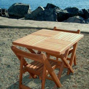 Square Folding Table (Options: 2 Folding Chairs, Douglas-fir, No Cushions, Standard Tabletop, Checkerboard Design, Squared Corners, No Umbrella Hole, Transparent Premium Sealant). Photo Courtesy of Quintas Papagayo's Hotel, Ensenada, Mexico.