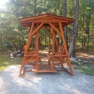 St. Anthony's Glider (Adult Size, Redwood, With Beverage Armrests, No Kid's Platform, Extra Wide Roof, No Engraving, Transparent Premium Sealant). Photo Courtesy of D. Jones of Lachine, Michigan.