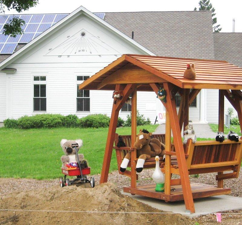 St. Anthony's Glider (XW Size, Redwood, No Kid's Platform, XW Roof, No Engraving, Transparent Premium Sealant).