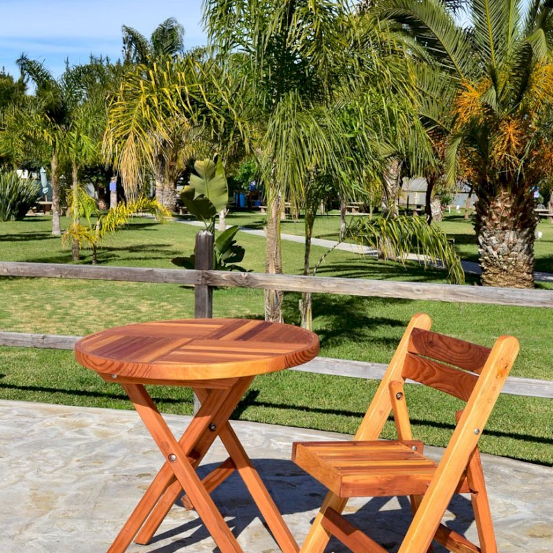 Folding Chair (Options: Redwood, No Cushion, Transparent Premium Sealant) and Round Folding Table.