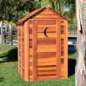 Storage Mini Barn (Options: 4.5' W, 4.5' D, 7' H, Redwood, Single Door, Transparent Premium Sealant). Crescent Moon cutout was optional request by customer.