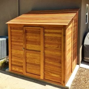 """Storage Shed (Options: 7' W, 4.5' D, 7' H, Redwood, Single Door, One Shelf on the Side Opposite the Door, 42"""" H, Transparent Premium Sealant). Photo Courtesy of J. Lewis of Mountain View, CA."""
