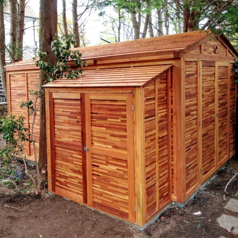 """Storage Shed (Options: 7' W, 3' D, 7' H, Mosaic Eco-Wood, Double Doors, Three Shelves at 28"""" H & 14"""" H, Transparent Premium Sealant). Photo Also Shows a Storage Mini Barn. Photo Courtesy of J. VanderKamp of Westport, Connecticut."""
