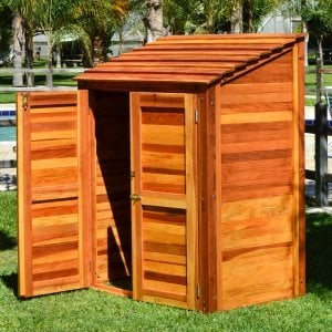 """Storage Shed (Options: 4.5' W, 3' D, 6' H, Redwood, Double Doors, One Shelf on the Side Opposite the Door, 42"""" Shelving Height, Transparent Premium Sealant)."""