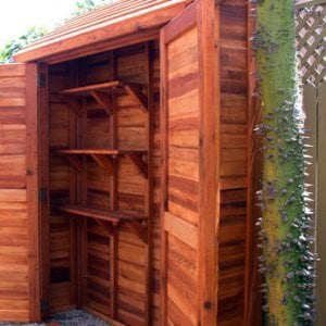 "Storage Shed (Options: 7' W, 2' D, 7' H, Redwood, Double doors, One Shelf, 42"", Transparent Premium Sealant)."