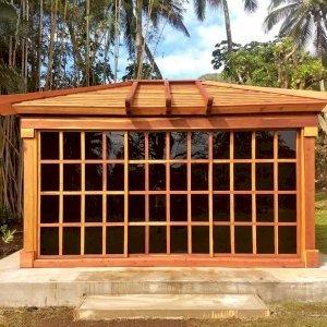 Sun Gazebo (Options: 14' L, 12' W, Redwood, 4' x 4' Skylight, Standard Wood Roof, Complete Floor, Transparent Premium Sealant). Photo Courtesy of C. Tokars of Kaneohe, Hawaii.