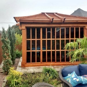 Sun Gazebo (Options: 12' L, 10' W, Mature Redwood, 7 ft Wall Height, Without Skylight, Standard Wood Roof, Hardware Kit for Stone, Brick or Concrete, Complete Floor, Transparent Premium Sealant). Photo Courtesy of J. Davidson of Plano, Texas.