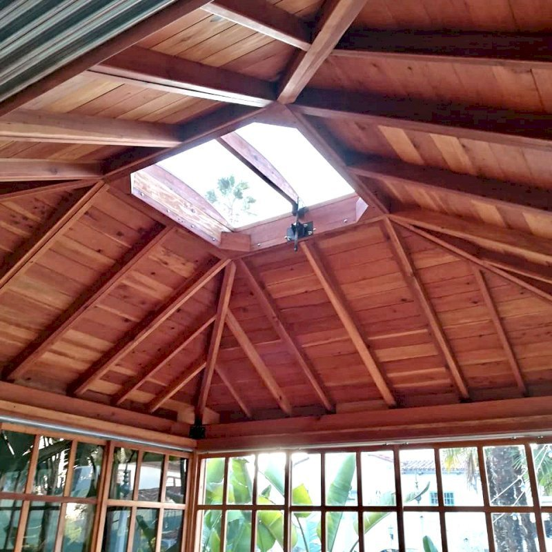 Sun Gazebo (Options: 14' L, 14' W, California Redwood, 8 ft Wall Height, 4' x 4' Skylight, Complete Floor, Transparent Premium Sealant). Photo Courtesy of M. Wunderman of Los Angeles, CA.