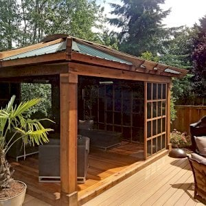 Sun Gazebo (Options: 14' L, 12' W, California Redwood, 4' x 4' Skylight, Complete Floor, Transparent Premium Sealant). Metal roof added by custom request. Photo Courtesy of P. Gee of Sammamish, Washington.