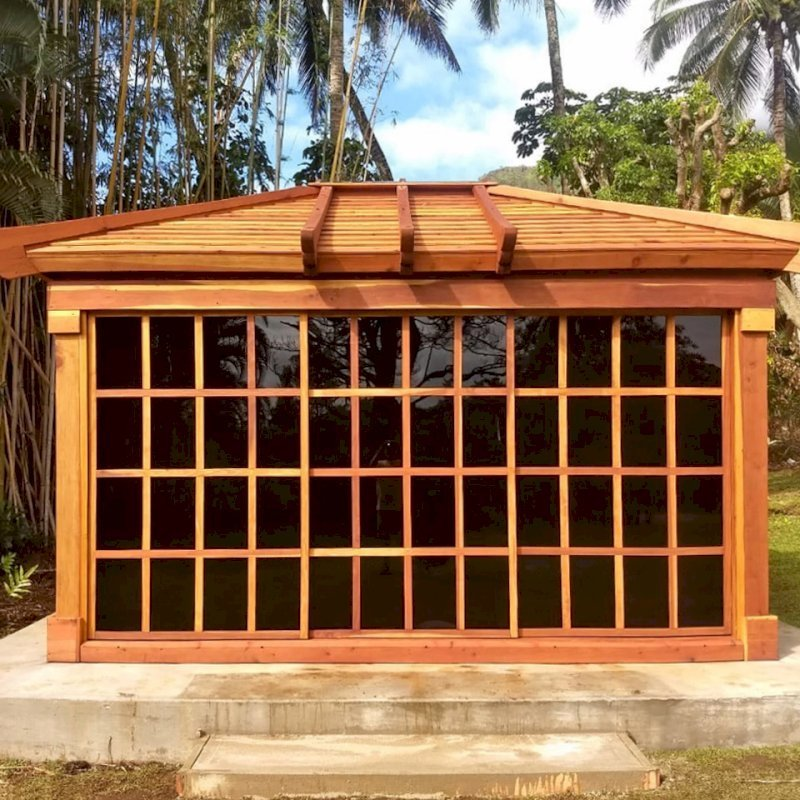 Sun Gazebo (Options: 14' L, 12' W, California Redwood, 4' x 4' Skylight, Standard Wood Roof, Complete Floor, Transparent Premium Sealant). Photo Courtesy of C. Tokars of Kaneohe, Hawaii.