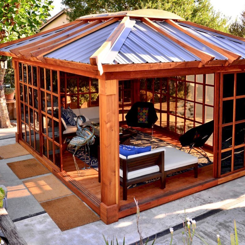 Sun Gazebo (Options: 14' L, 12' W, California Redwood, 4' x 6' Skylight, Complete Floor, Transparent Premium Sealant). Metal roof added by custom request. Photo Courtesy of A. Ramon of South San Francisco, CA. Note: Metal Roof provided by Home Depot: 12ft. Classic Rib Steel Roof Panel in Charcoal, Model #2313417, Internet #204255071