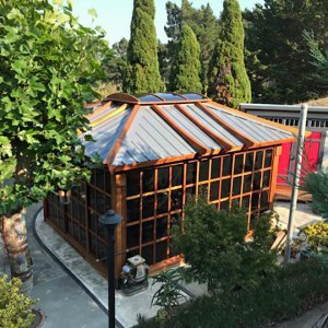 Sun Gazebo (Options: 14' L, 12' W, Redwood, 4' x 6' Skylight, Complete Floor, Transparent Premium Sealant). Metal roof added by custom request. Photo Courtesy of A. Ramon of South San Francisco, CA. Note: Metal Roof provided by Home Depot: 12ft. Classic Rib Steel Roof Panel in Charcoal, Model #2313417, Internet #204255071