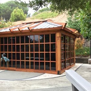 Sun Gazebo (Options: 14' L, 12' W, California Redwood, 4' x 6' Skylight, Complete Floor, Transparent Premium Sealant). Metal roof added by custom request. Photo Courtesy of A. Ramon of South San Francisco, CA. Note: Metal Roof has Provided by Home Depot: 12ft. Classic Rib Steel Roof Panel in Charcoal. Model #2313417, Internet #204255071