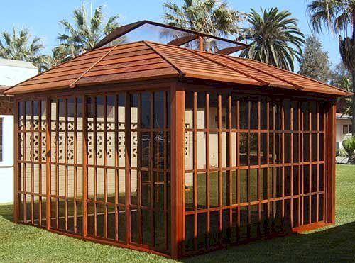Sun Gazebo (Options: 12' L, 12' W, Mature Redwood, 4' x 8' Skylight, No Flooring, Transparent Premium Sealant). Please note photo was taken with two rear wall panels all removed to add light so you can see thru the remaining front walls clearly.