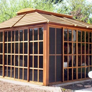 Sun Gazebo (Options: 12' L, 12' W, Mature Redwood, 4' x 8' Skylight, No Flooring,  Transparent Premium Sealant). Photo shows optional screen panels.