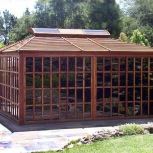 Sun Gazebo (Options: 16' L, 16' W, Redwood, 4' x 8' Skylight, No Flooring, Transparent Premium Sealant). All Wall Panels Closed.