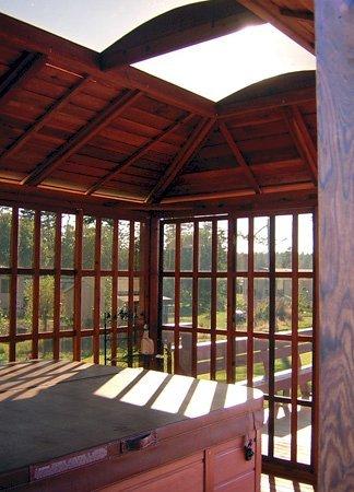 Sun Gazebo Interior with Hot Tub (Options: 12' L, 12' W, Redwood, 4' x 8' Skylight, No Flooring, Transparent Premium Sealant). Hot tub not included.