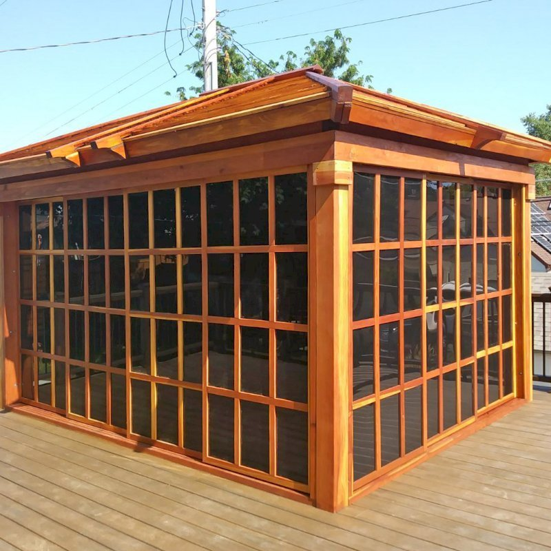 Sun Gazebo (Options: 14' L, 10' W, California Redwood, No Skylight, No Flooring, Transparent Premium Sealant). Photo Courtesy of L. Lundsten of St. Paul, MN.