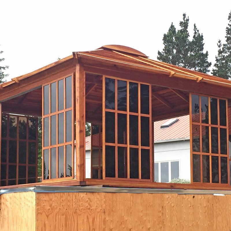 Sun Gazebo (Options: 16' L, 16' W, California Redwood, 4' x 4' Skylight, No Flooring, Transparent Premium Sealant). Photo shows only 8 doors/panels, the rest were installed after the photo was taken. Photo Courtesy of L. Moresco of San Francisco, CA.