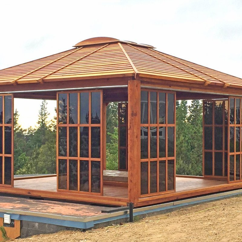 Sun Gazebo (Options: 16' L, 16' W, Redwood, 4' x 4' Skylight, No Flooring, Transparent Premium Sealant). Photo shows only 8 doors/panels, the rest were installed after the photo was taken. Photo Courtesy of L. Moresco of San Francisco, CA.