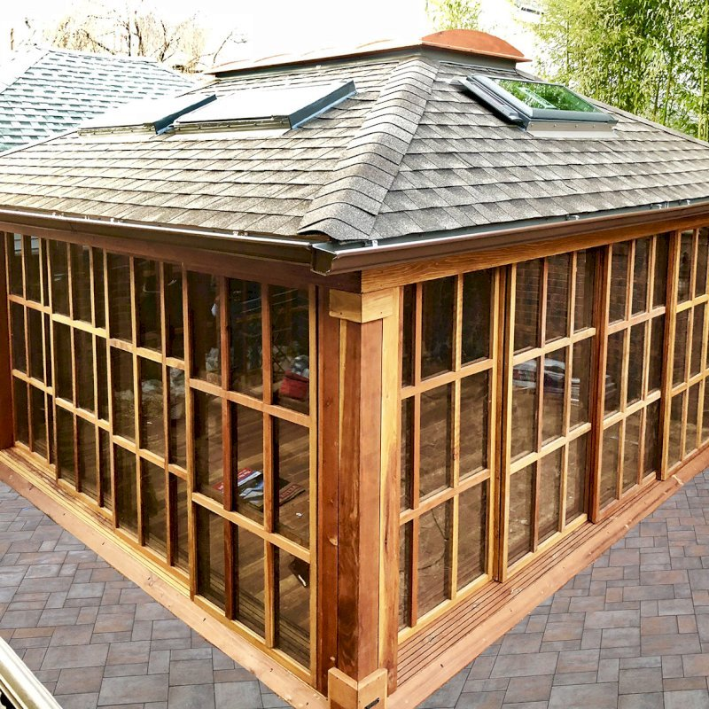 Sun Gazebo (Options: 16' L, 16' W, California Redwood, 4' x 8' Skylight, Complete Floor, Transparent Premium Sealant). Skylights and asphalt shingles by custom request. Photo Courtesy of S. Alishaev of New York, NY.