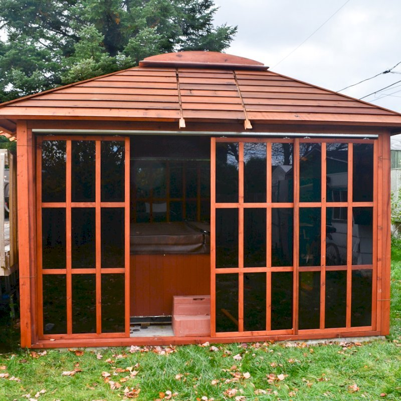 Sun Gazebo (Options: 12' L, 12' W, Mature Redwood, 4' x 8' Skylight, No Flooring, Transparent Premium Sealant). Photo Courtesy of Stephane Jean of Chicoutimi, Quebec.
