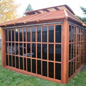 Sun Gazebo (Options: 12' L, 12' W, Mature Redwood, 4' x 8' Skylight, No Flooring, Transparent Premium Sealant). Photo Courtesy of Stephane Jean of Chicoutimi, Quebec.